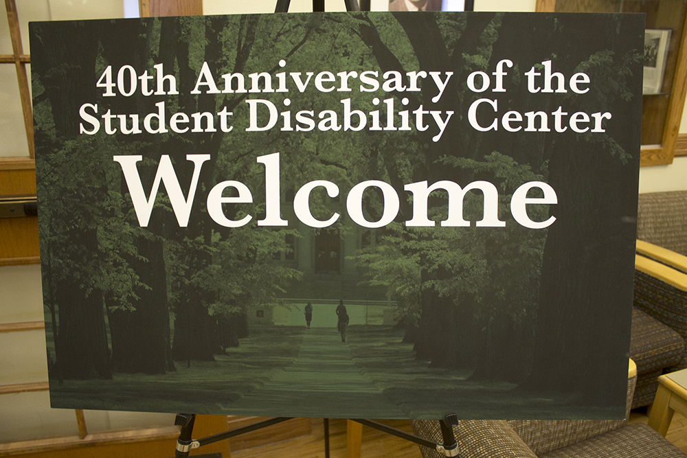 "A sign that says ""40th anniversary of the Student Disability Center, Welcome""."