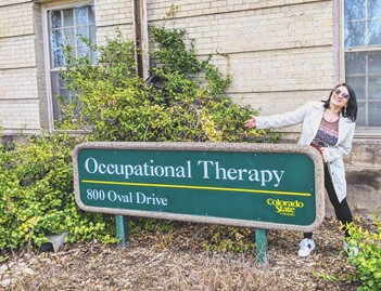 Katerina Burko with Occupational Therapy sign